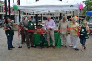 Mayor Ed Kennedy cuts the ribbon at CTI Farmers' Market. Photo courtesy Marie Sweeney